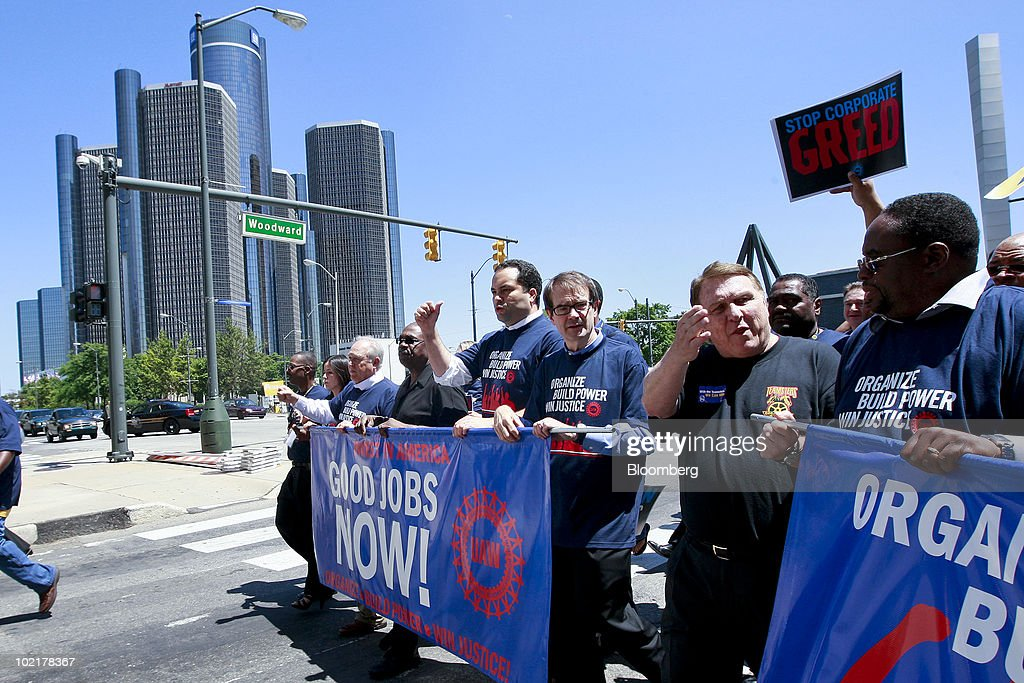 Protesters, from center left, Benjamin Todd Jealous, president and chief executive officer of the National Association for the Advancement of Colored People (NAACP), Bob King, the new president of the United Auto Workers union (UAW), James 'Jimmy' Hoffa, International Brotherhood of Teamsters president, and Jimmy Settles, vice president of the UAW, lead a demonstration past the headquarters of General Motors Co. against Wall Street following the UAW 35th Constitutional Convention in Detroit, Michigan, U.S., on Monday, June 17, 2010. King, an electrician with a law degree, was elected the 10th president of the UAW, inheriting a union fighting to restore the wages and benefits it gave up to save the U.S. auto industry and succeeding two-term President Ron Gettelfinger. Photographer: Jeff Kowalsky/Bloomberg via Getty Images