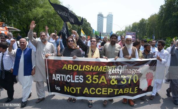 Protesters from different groups including All Parties Hurriyat Conference a Kashmiri group hold placards during an antiIndia protest near the Indian...