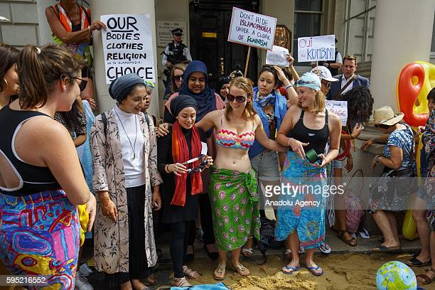 Protesters from different societies stage a demonstration named Wear What You Want themed as a beach party style outside the French Embassy in London...