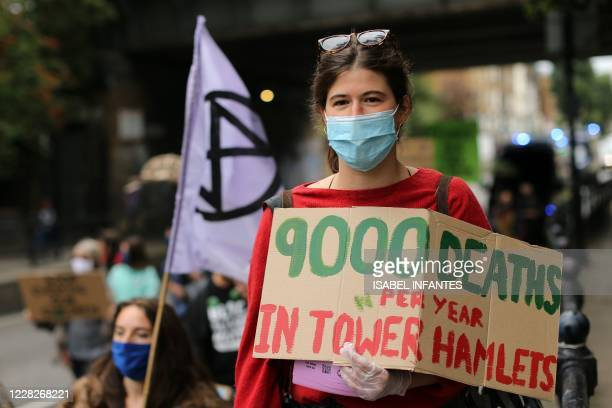 Protesters from Extinction Rebellion march through the streets of Tower Hamlets to highlight unsafe pollution levels in east London on August 30...