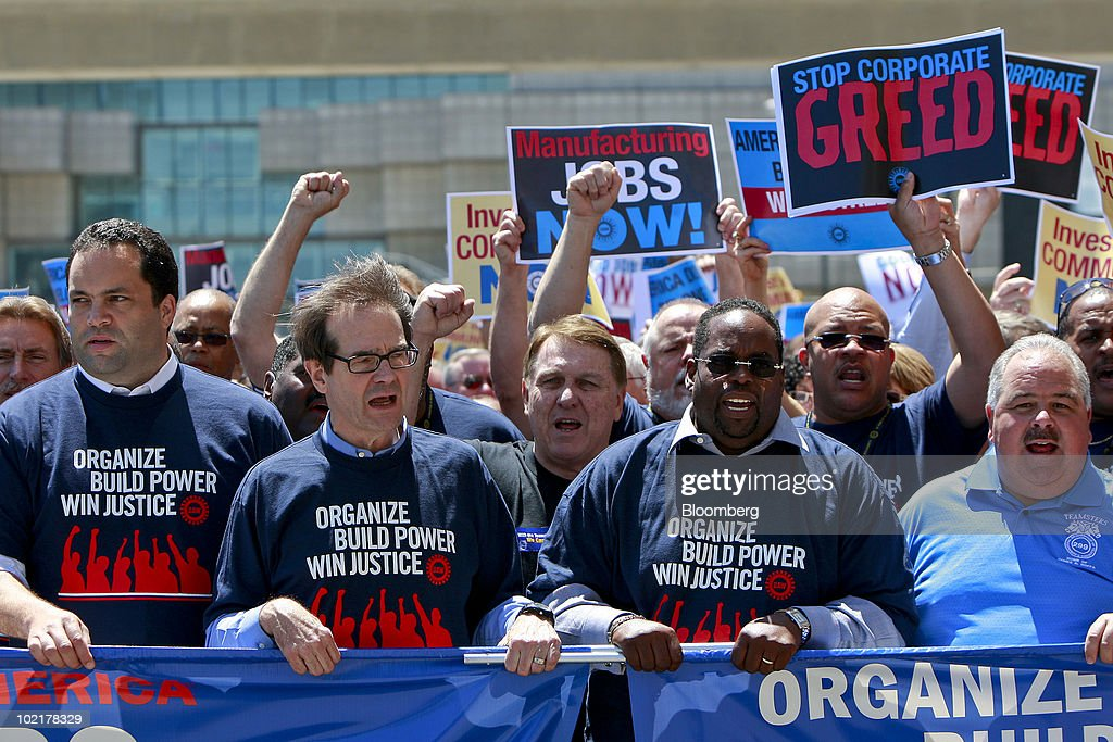 Protesters, from left, Benjamin Todd Jealous, president and chief executive officer of the National Association for the Advancement of Colored People (NAACP), Bob King, the new president of the United Auto Workers union (UAW), James 'Jimmy' Hoffa, International Brotherhood of Teamsters president, and Jimmy Settles, vice president of the UAW, lead a demonstration against Wall Street following the UAW 35th Constitutional Convention in Detroit, Michigan, U.S., on Monday, June 17, 2010. King, an electrician with a law degree, was elected the 10th president of the UAW, inheriting a union fighting to restore the wages and benefits it gave up to save the U.S. auto industry and succeeding two-term President Ron Gettelfinger. Photographer: Jeff Kowalsky/Bloomberg via Getty Images