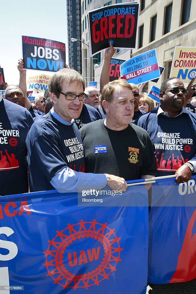 Protesters, from left, Bob King, the new president of the United Auto Workers union (UAW), James 'Jimmy' Hoffa, International Brotherhood of Teamsters president, and Jimmy Settles, vice president of the UAW, lead a demonstration against Wall Street following the UAW 35th Constitutional Convention in Detroit, Michigan, U.S., on Monday, June 17, 2010. King, an electrician with a law degree, was elected the 10th president of the UAW, inheriting a union fighting to restore the wages and benefits it gave up to save the U.S. auto industry and succeeding two-term President Ron Gettelfinger. Photographer: Jeff Kowalsky/Bloomberg via Getty Images