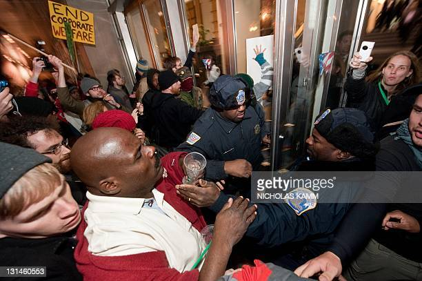 Protesters from Occupy DC march scuffle with police in front of the entrance of the Washington Convention Center during a demonstration against the...