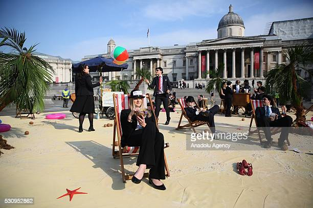 Protesters from Oxfam Action Aid and Christian Aid stage a protest against tax havens at Trafalgar Square during the Global Anticorruption Summit in...