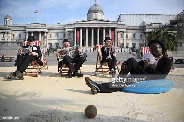 Protesters from Oxfam Action Aid and Christian Aid stage a protest to demonstrate against tax havens at Trafalgar Square during the Global...