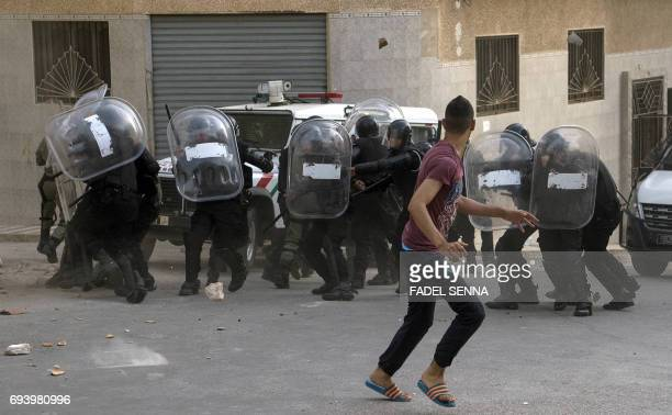 Protesters from Rif movement clash with security forces after a demonstration against the government in alHoceima on June 8 2017 Police fired tear...