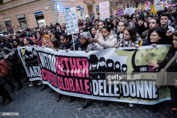 Protesters from several feminists and womens groups take part in a march organised by 'Non Una Di Meno to mark the international Women's Day in Rome...
