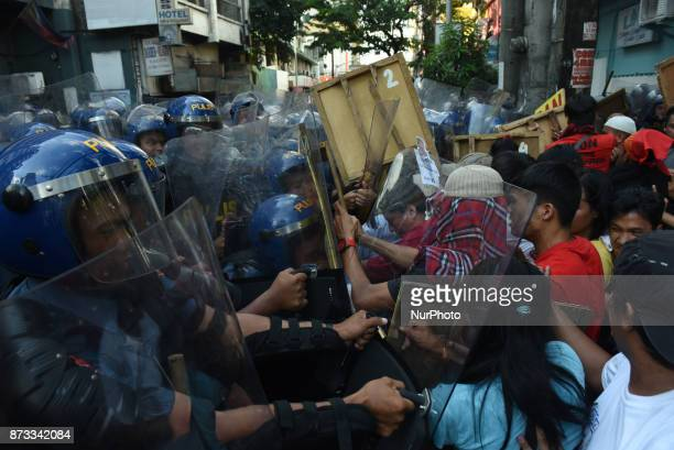 Protesters from southern Philippines try to get past antiriot police in their attempt to march towards the United States Embassy in Manila to air...