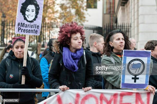 Protesters from the Brazilian Women Against Fascism UK group are seen holding a banners and placards during the protest Huge crowds marched from the...