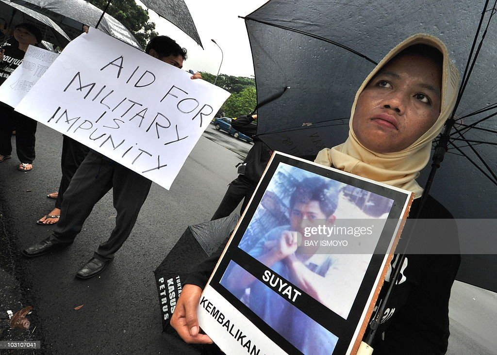 Protesters from the Commission for Disappeareances and Victims of Violence show photographs of their missing family members and placards during a protest in front of US embassy in Jakarta on July 27, 2010. The activists were protesting against the US military's resumption of ties with Indonesian special forces who they accused of ongoing human rights violations. US Defense Secretary Robert Gates announced last week in Jakarta that theUS would resume ties with Kopassus, an elite unit said to have been responsible for atrocities and mass repression under the late dictator Suharto. AFP PHOTO / Bay ISMOYO