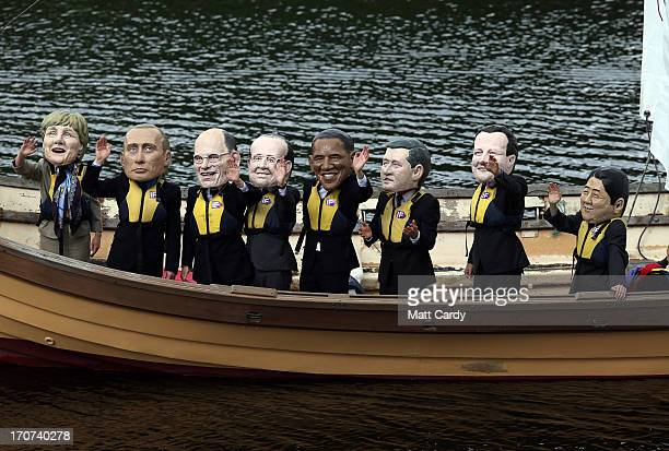 Protesters from the Enough Food For Everyone IF coalition dressed in giant G8 leaders heads sail in a Viking style boat close to the Kellyhevlin...