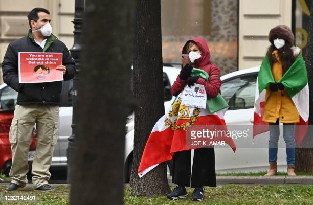 Protesters from the exile are seen near the Grand Hotel in Vienna on April 6 where diplomats of the EU, China, Russia and Iran will hold talks. - The...