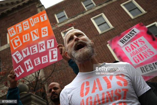 Protesters from the group Gays Against Guns hold a gun law reform demonstration outside the Hart Senate Office Building November 6 2017 in Washington...