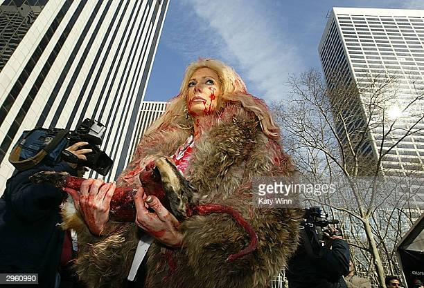 Protesters from the People for the Ethical Treatment of Animals demonstrate during Olympus Fashion Week in Bryant Park February 10 2004 in New York...