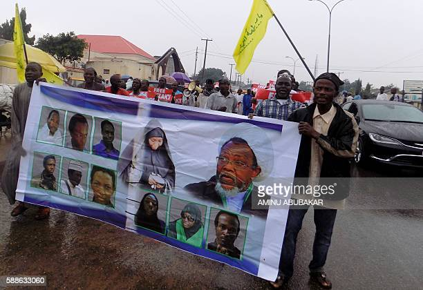 Protesters from the proIranian Islamic Movement in Nigeria carry banners during a march in the streets to press for the release of their leader...