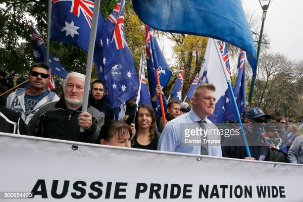 Protesters from the 'True Blue Crew' march on June 25 2017 in Melbourne Australia An anti racist rally was organised to counter an 'Australian pride...