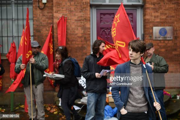 Protesters from the Young Communist League take part in an antiausterity demonstration organised by The People's Assembly in Manchester to coincide...