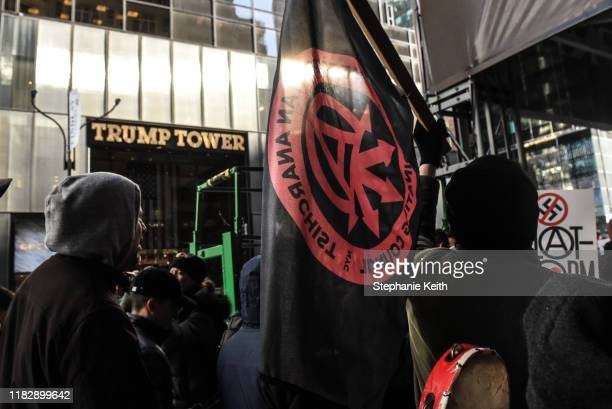 Protesters from various antifascist groups pass by Trump Tower during a rally against the Proud Boys on November 16 2019 in New York City Two members...