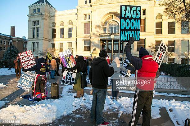 Protesters from Westboro Baptist Church picket the samesex marriage ceremony Monday Nov 17 2014 on the steps of the Historic Sedgwick County...