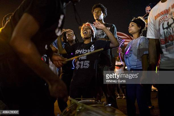 Protesters gather across the street from the police department on September 30 2014 in Ferguson Missouri Protests continued in the St Louis suburb...