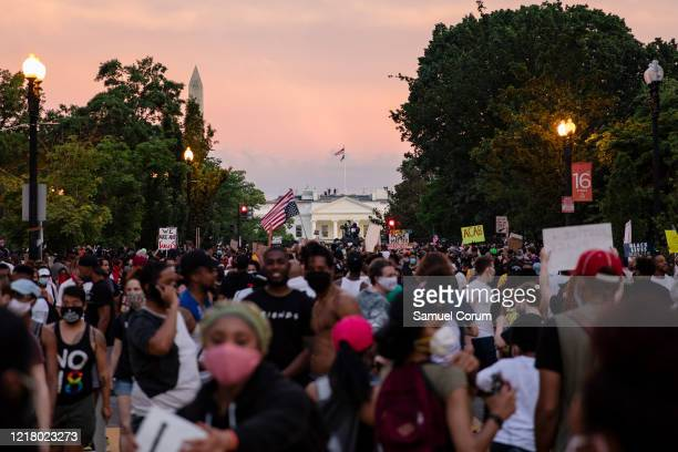 Protesters gather along the recently rename Black Lives Matter Plaza near the White House as the sun sets during continued demonstrations on June 6...