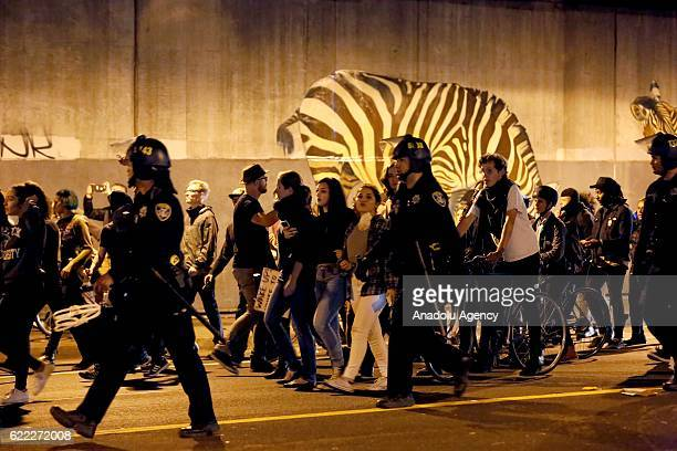 Protesters gather and block the roads of the downtown of Oakland during a protest against Presidentelect Donald Trump of Republican Party in Oakland...