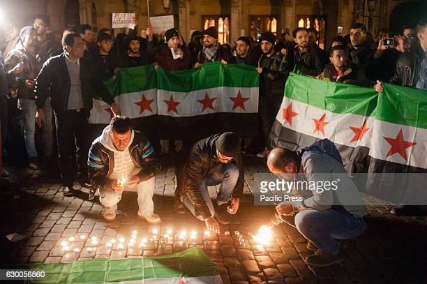 Protesters gather and light candles at a wake on the Grand Place Square in Brussels in solidarity with the people in aleppo