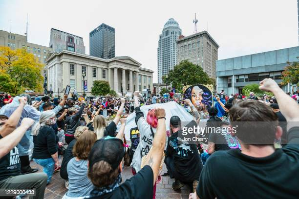 Protesters gather and raise their fists around the Breonna Taylor memorial at Jefferson Square Park on October 10, 2020 in Louisville, Kentucky....