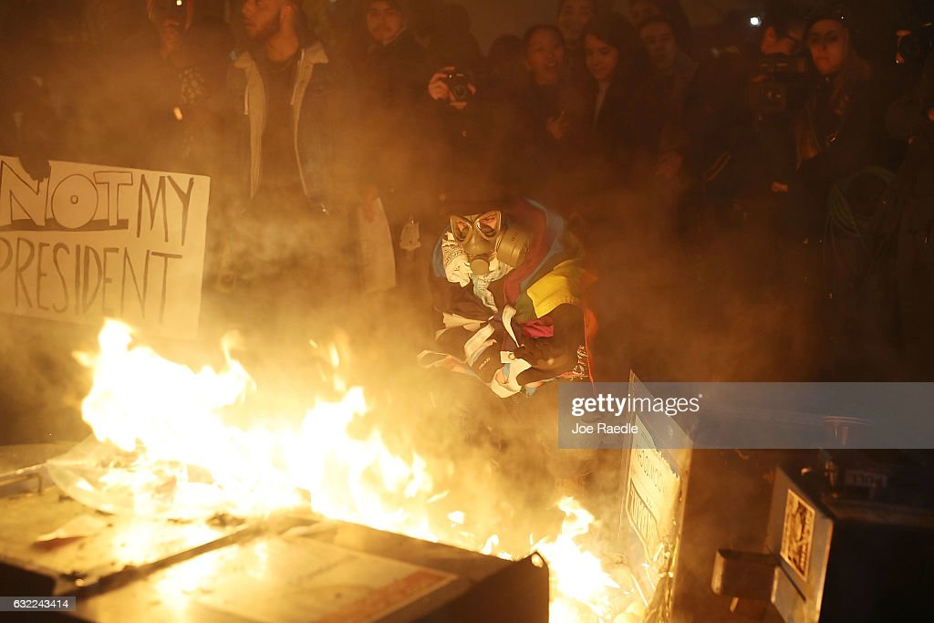 Protesters gather around a fire they built in the street as they make themselves heard following the inauguration of President Donald Trump on January 20, 2017 in Washington, DC. Earlier today Donald Trump was inaugurated as the 45th President of the United States.