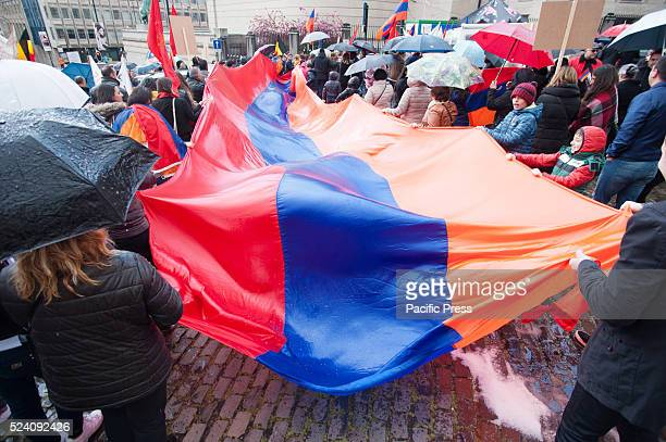 Protesters gather around a huge Armenian flag at the commemoration in Brussels of the Armenian genocide 101 years ago It is 101 years ago that the...