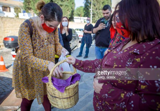 Protesters gather around a picnic basket in the northern part of Nicosia, the capital of the self-proclaimed Turkish Republic of Northern Cyprus ,...