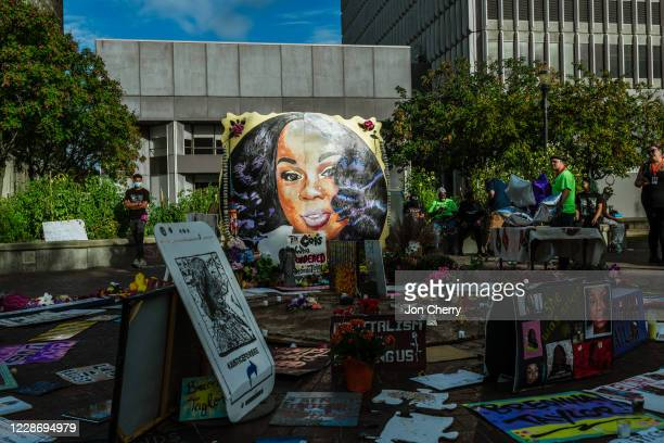 Protesters gather around the memorial shrine dedicated to Breonna Taylor in Jefferson Square Park on September 24 2020 in Louisville Kentucky...