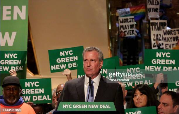 Protesters gather as Mayor Bill De Blasio holds a Green New Deal rally At Trump Tower in New York City on May 13 2019. Mayor de Blasio recently...