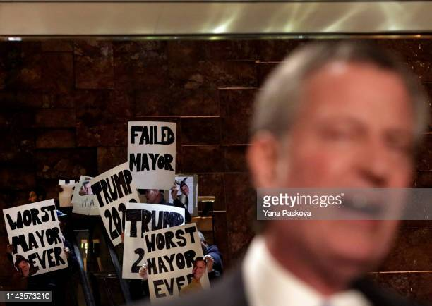 Protesters gather as Mayor Bill De Blasio holds a Green New Deal rally At Trump Tower in New York City on May 13 2019 Mayor de Blasio recently...