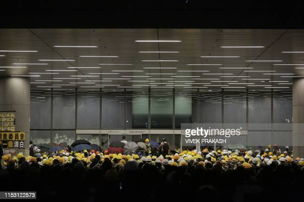Protesters gather as they attempt to break into the government headquarters in Hong Kong on July 1 on the 22nd anniversary of the city's handover...
