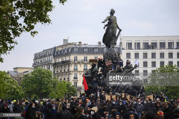 Protesters gather as they clash with police at May Day Demonstration in Paris on May 01, 2021. Students also attend the protest demanding for better...