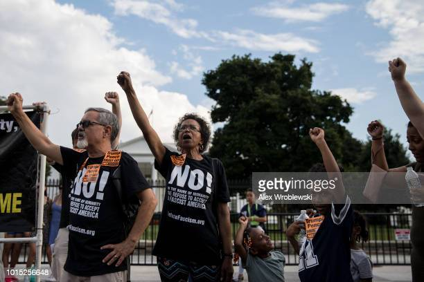Protesters gather at a demonstration organized by Refuse Fascisim in front of the White House on August 11 2018 in Washington DC A 'Unite the Right'...