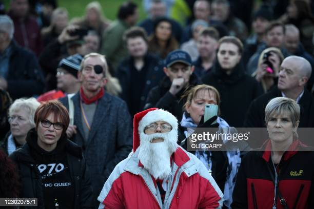 """Protesters gather at a """"Memorial March"""" in central Newcastle-upon-Tyne, in north-east England on December 19 to unite against restrictions imposed to..."""