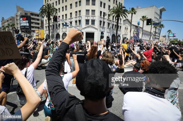 Protesters gather at a peaceful demonstration over George Floyd's death in Hollywood on June 3 2020 in Los Angeles California California Governor...