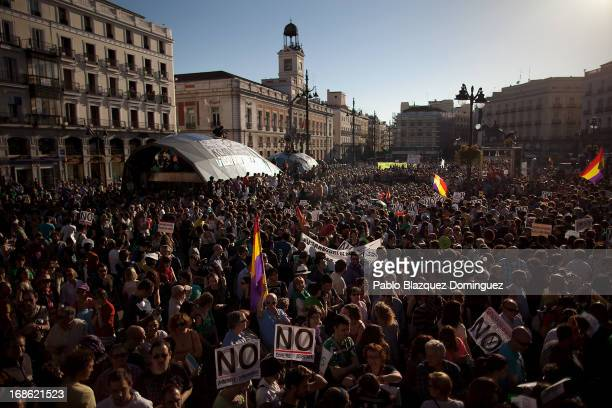 Protesters gather at a rally of Spain's Indignant movement at Puerta del Sol Square on May 12 2013 in Madrid Spain Demonstrations under the slogan...