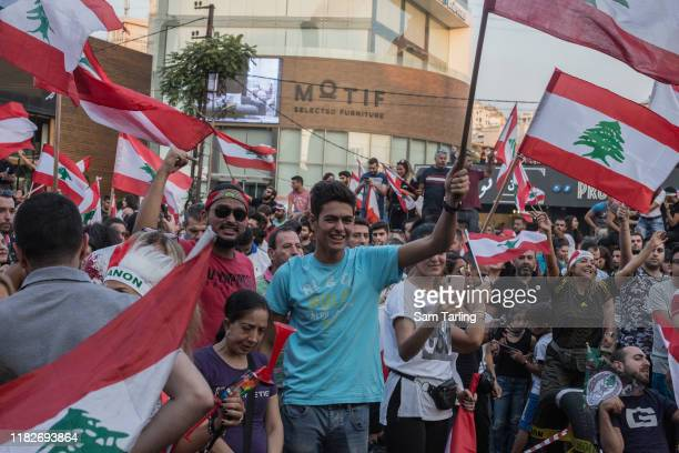 Protesters gather at an anti-government demonstration blocking the main highway north of Beirut, on October 22, 2019 in Beirut, Lebanon. Despite...