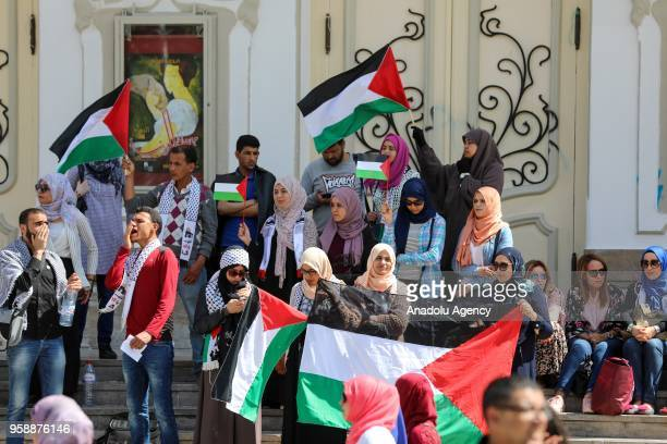 Protesters gather at Avenue Habib Bourguiba to stage a protest against United States' plans to relocate the US Embassy from Tel Aviv to Jerusalem and...