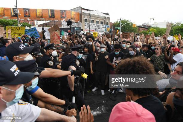 Protesters gather at Barclays Center to protest the recent killing of George Floyd on May 29, 2020 in Brooklyn in New York City. Demonstrations are...