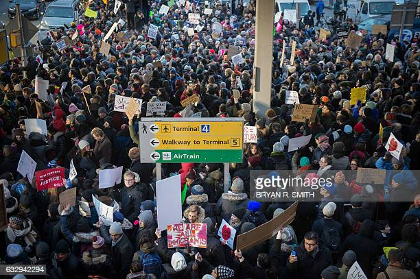 Protesters gather at JFK International Airport against Donald Trump's executive order on January 28 2017 in New York US President Donald Trump has...