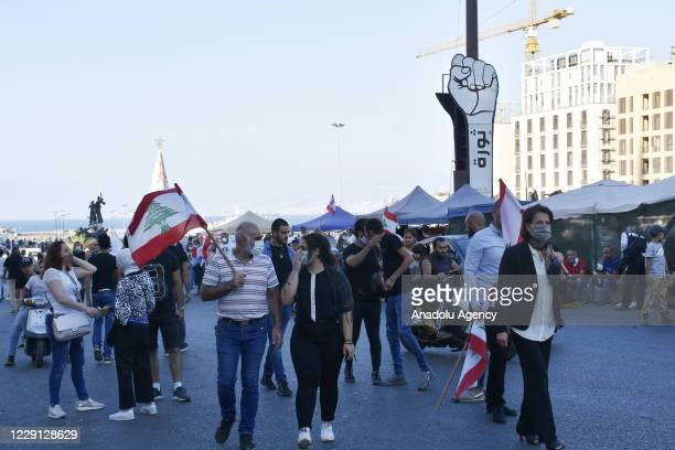 Protesters gather at Martyrs' Square to march towards Central Bank's building on the first anniversary of the Oct. 17, 2019 Lebanese protests over...