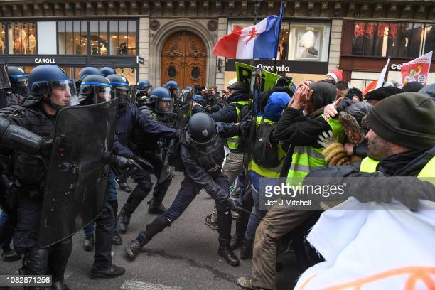 Protesters gather at Place de l' Opera during the 'yellow vests' demonstration on December 15, 2018 in Paris, France. The protesters gathered in...