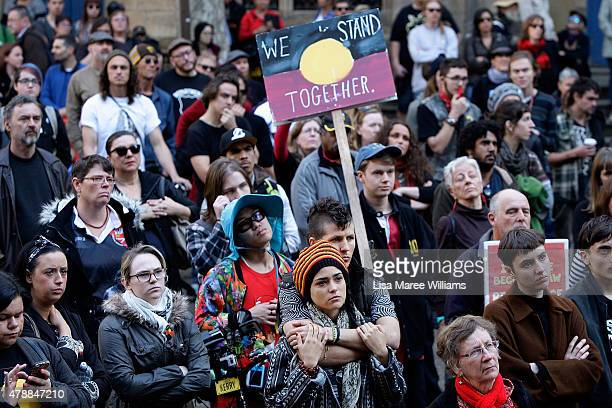 Protesters gather at Sydney Town Hall against the Governments treatment of Aboriginals on June 28 2015 in Sydney Australia A large number of...