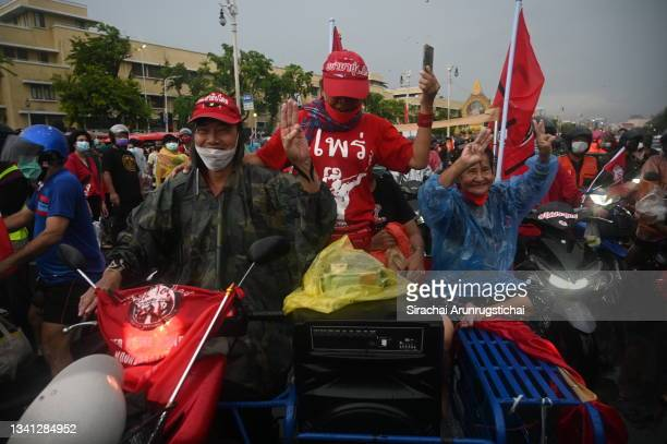 """Protesters gather at the Democracy Monument during a """"car mob rally"""" on the 15th anniversary of 2006 coup d'etat on September 19, 2021 in Bangkok,..."""
