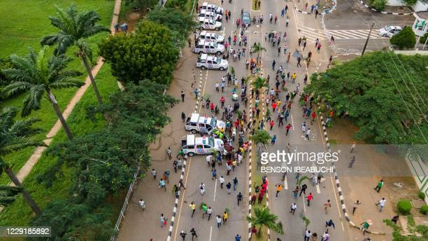 Protesters gather at the front of Alausa, the Lagos State Secretariat, while chanting a people united can never be defeated in Lagos on October 20...