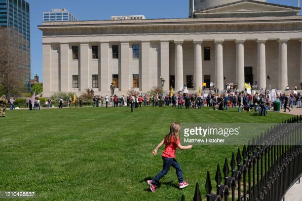 Protesters gather at the Ohio Statehouse to protest the 'Stay at Home' order on April 20, 2020 in Columbus, Ohio. The order was put into place by...